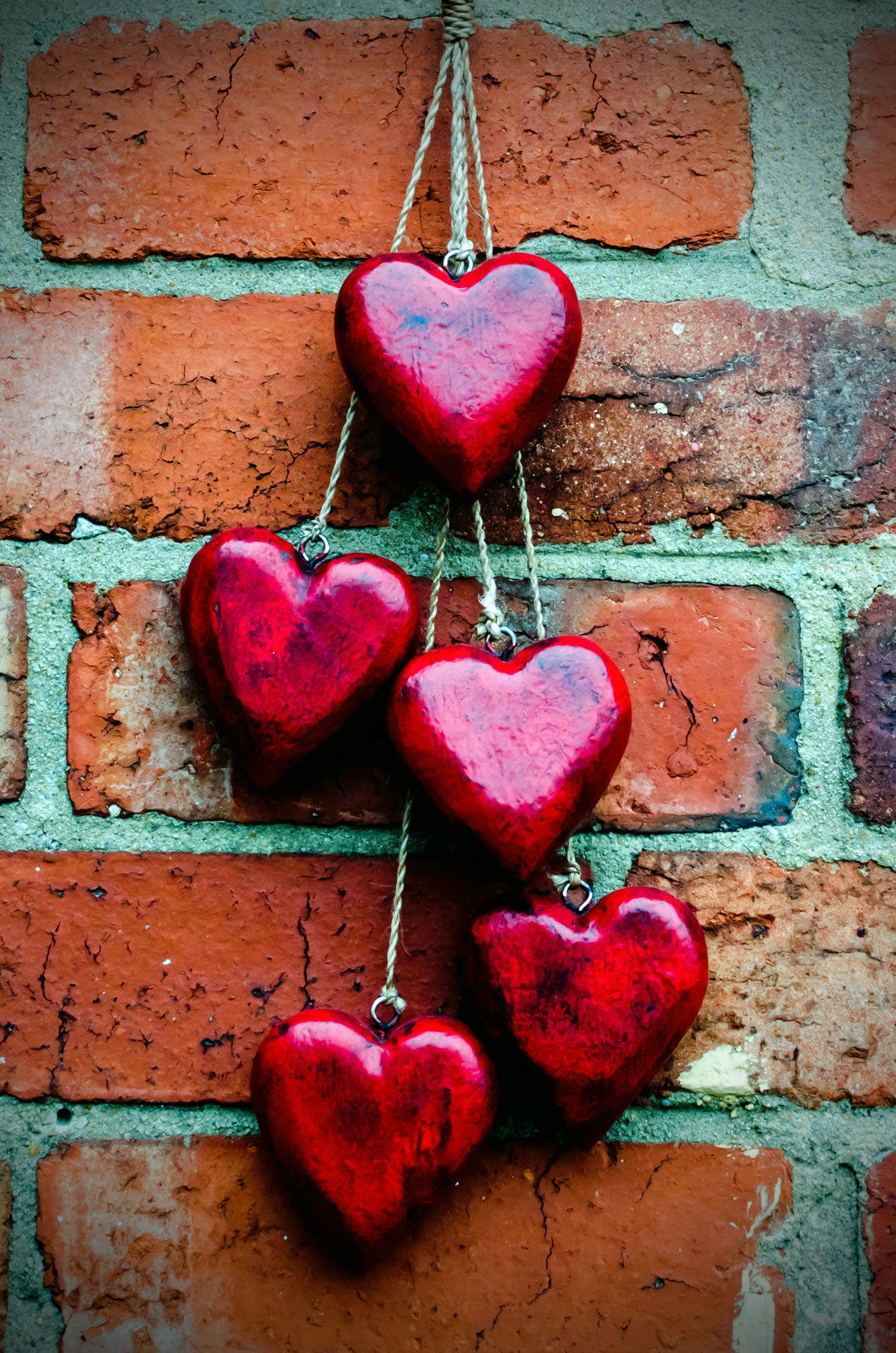 red heart on a brick wall