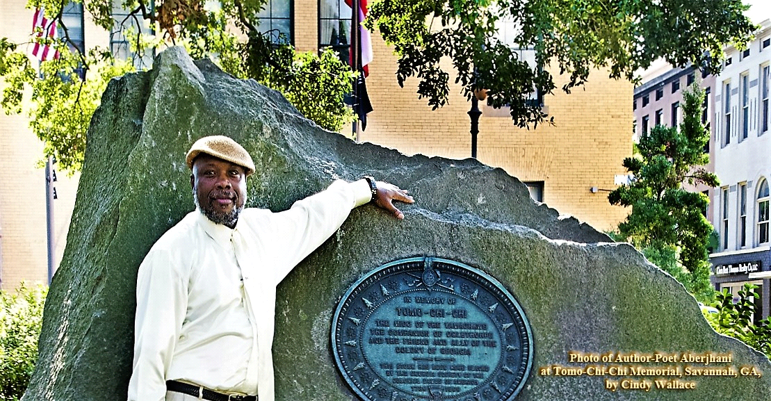 Photograph of Aberjhani in front of Tomo Chi Chi memorial in Savannah GA by Cindy Wallace